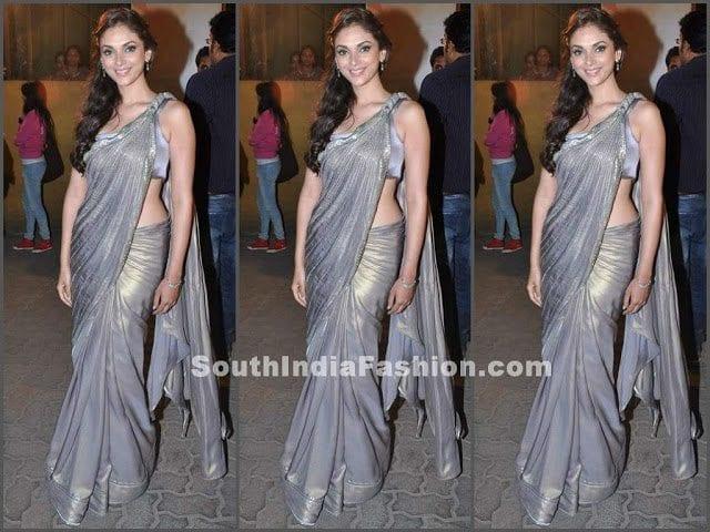 713ce81e854 garrav gupta grey saree. Bollywood actress in plain grey shimmer georgette  ...