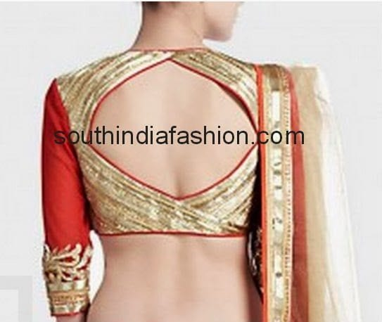 color blouse with diamond shaped opening on the back with red piping