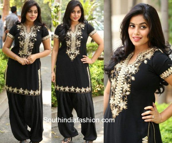 Poorna in a black mirror work salwar suit at Raju Gari Gadhi success meet