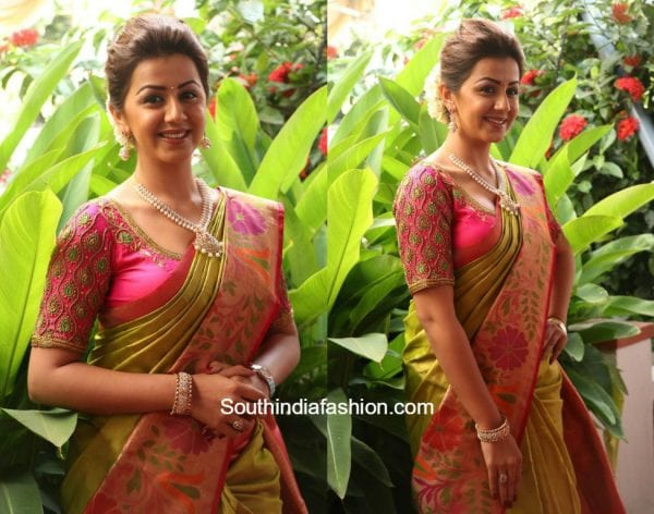 Nikki Galrani in a kanchipuram saree at Neruppuda Audio Launch 600x472