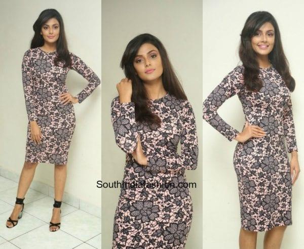 Anisha Ambrose in a dress