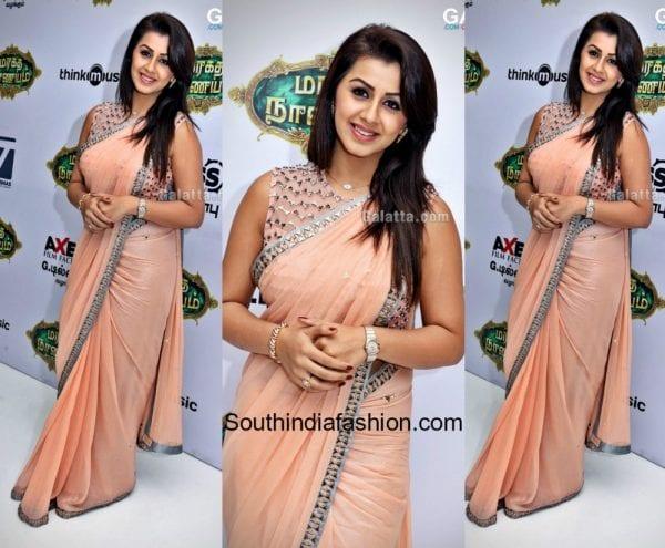 Nikki Galrani in a peach saree at Maragatha Naanaya Premiere Show