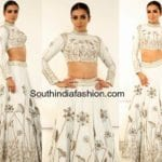 Catherine Tresa in a white long skirt and crop top