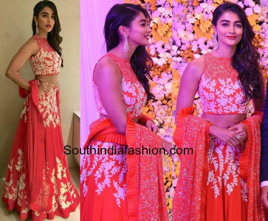 pooja hegde in samantha and naga chaitanya wedding reception in manish malhotra red lehenga
