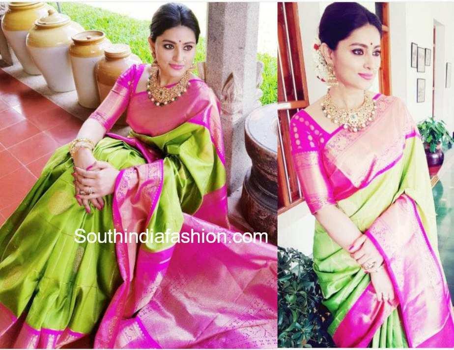 actress sneha prasanna in a green pattu saree at a wedding
