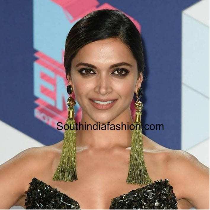 Deepika in green coloured tassel earrings