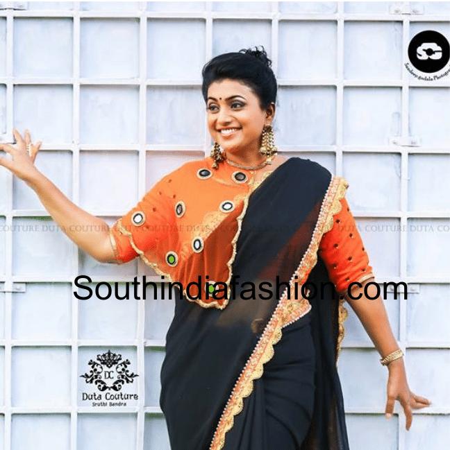 Roja in black saree orange cape blouse