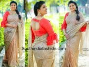 roja in gold saree and ruffle sleeves blouse
