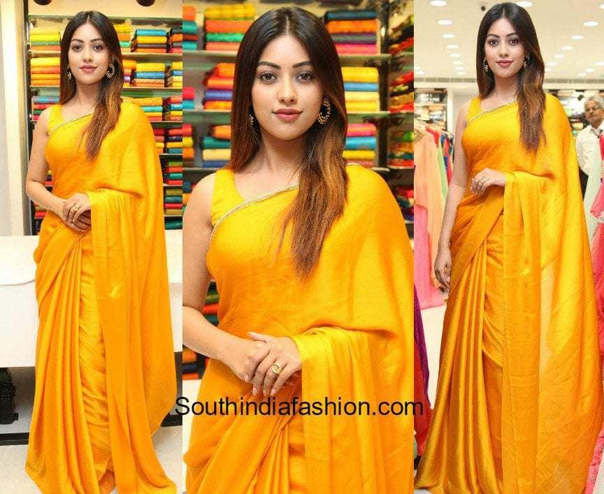 Anu Emmanuel in an orange saree at KLM Fashion Mall Launch