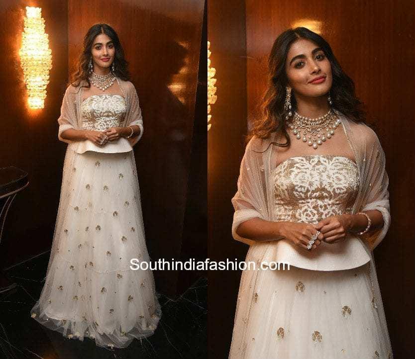 Pooja Hegde in a white lehenga