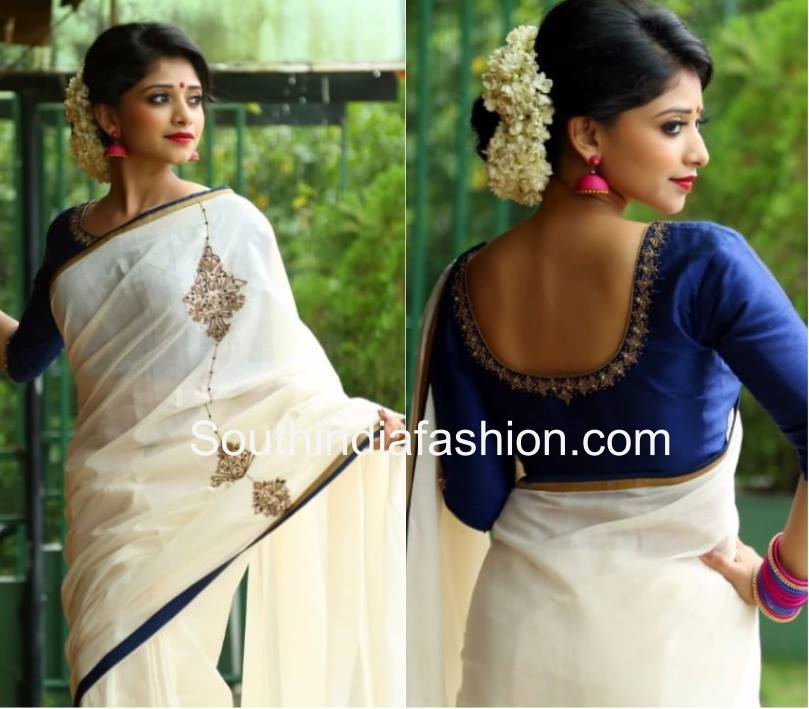 White saree and blue blouse