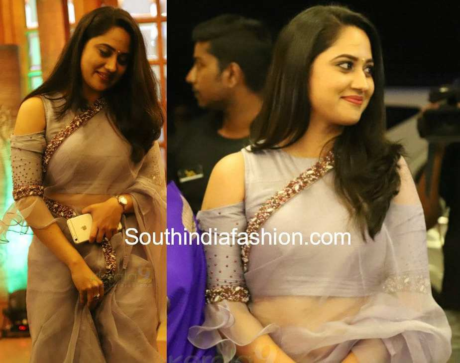 miya george in label m grey net saree and cold shoulder blouse