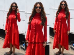 Esha Gupta in a red dress on the sets of a shoot