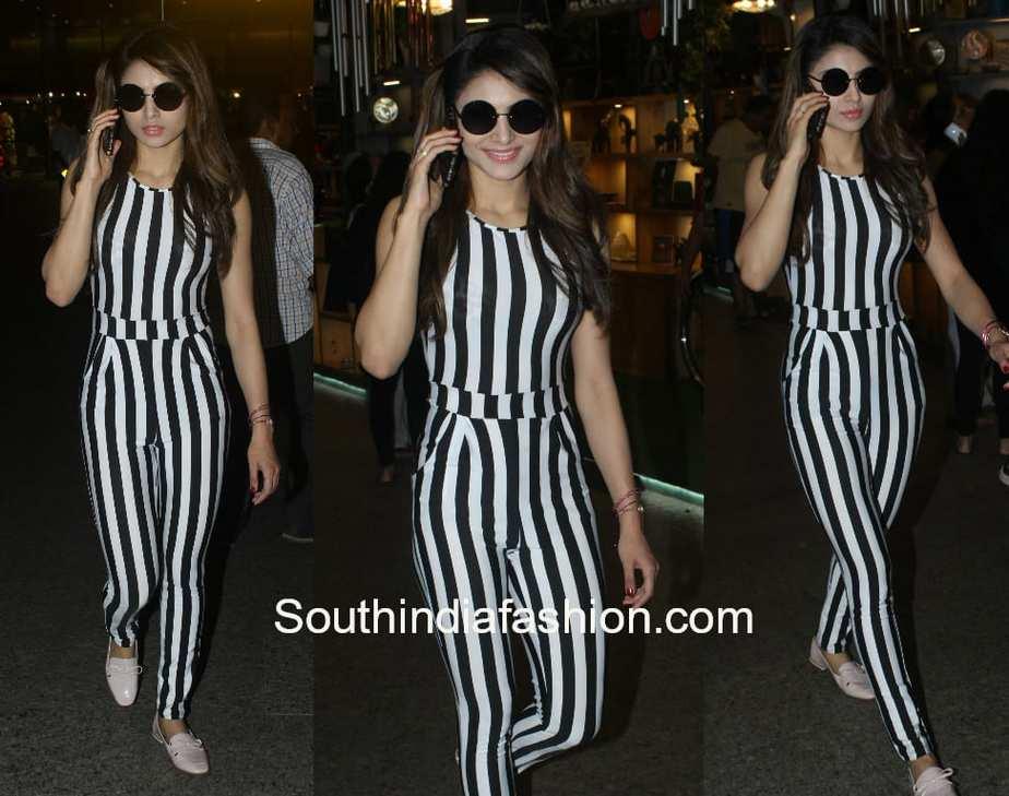 urvashi rautela airport striped jumpsuit