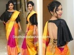nithya shetty yellow saree black cape blouse