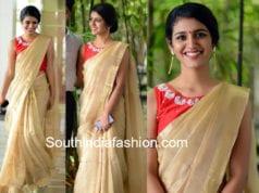 priya varrier in gold saree at vishwaroopam 2 press meet