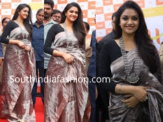 keerthy suresh in grey tissue saree with silver jewellery