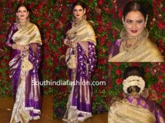 rekha in gold and purple kanjeevaram saree at deepika ranveer wedding reception