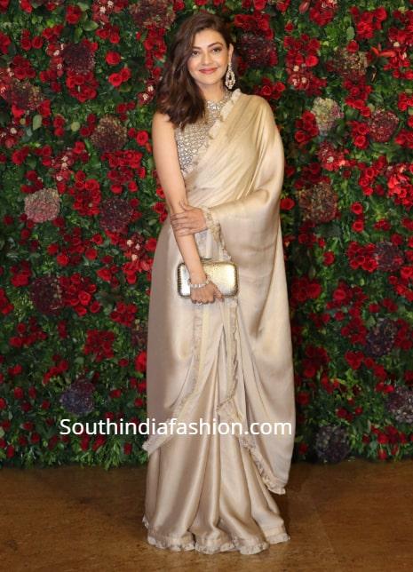kajal aggarwal in gold saree at deepika ranveer wedding reception