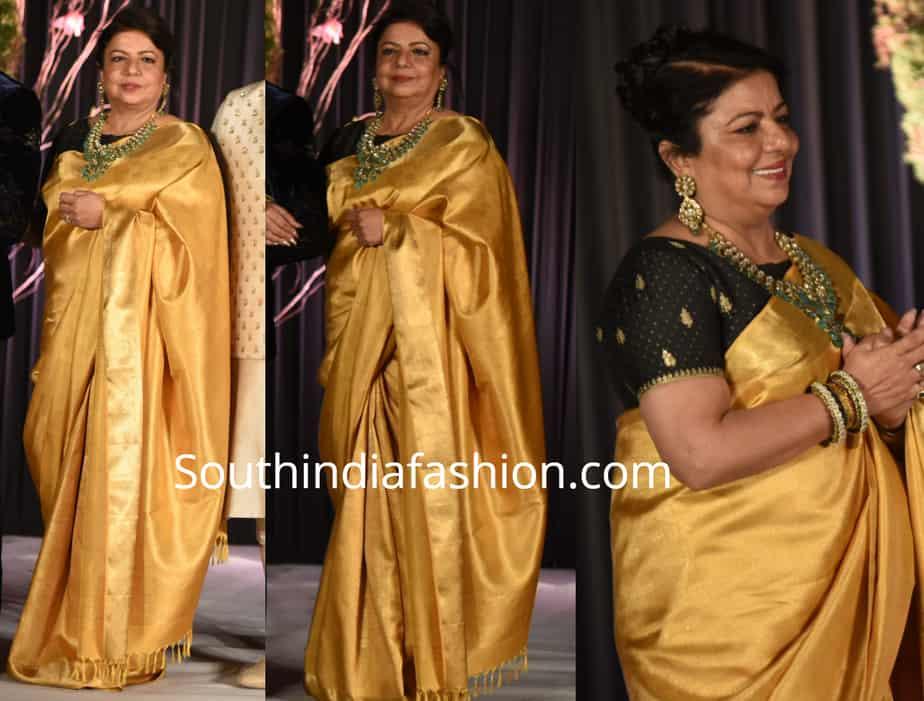 priyanka chopra mother madhu chopra yellow kanjeevaram saree at priyanka wedding reception