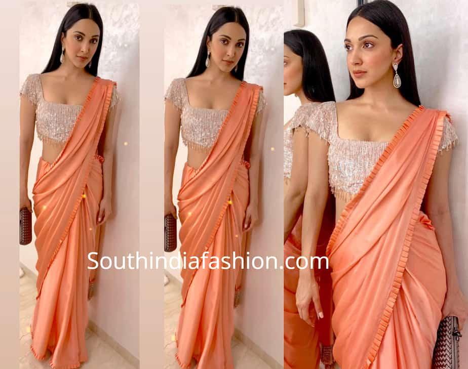 kiara advani in peach ruffle saree at a wedding