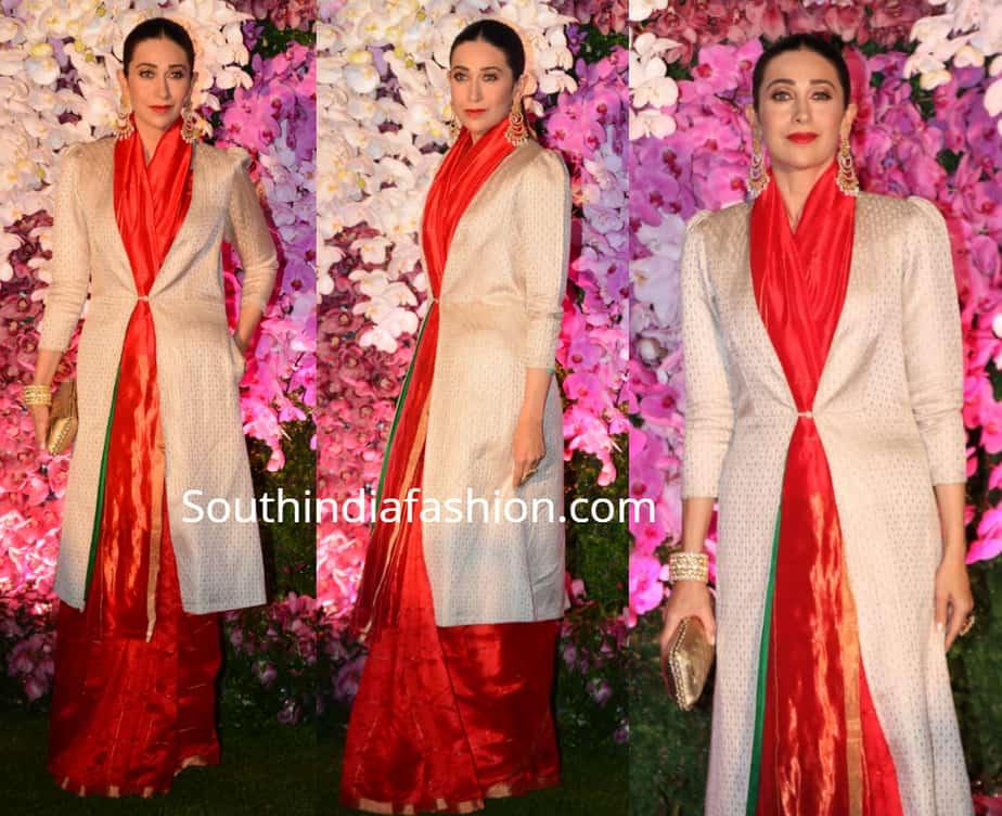 karisma kapoor in tred raw mango saree with long jacket at akash ambani reception