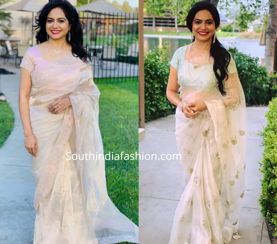 Singer Sunitha in white organza sarees
