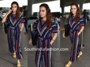 Dia Mirza in a striped jumpsuit at the airport