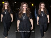 Raveena Tandon in a black outfit at the airport
