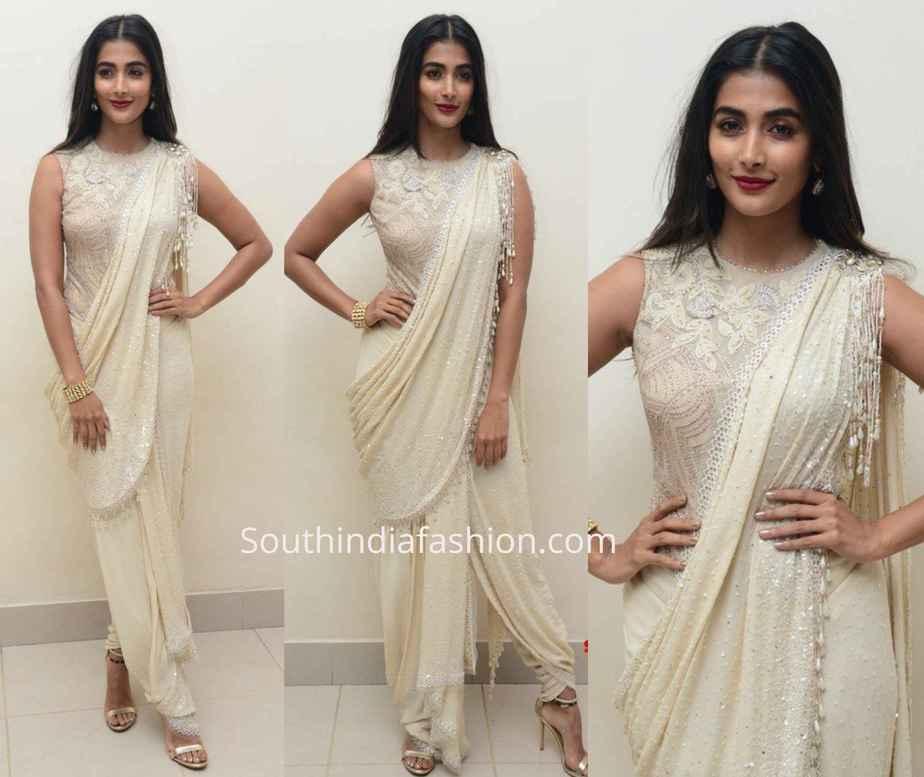 pooja hegde white dhoti saree at valmiki pre relesae event