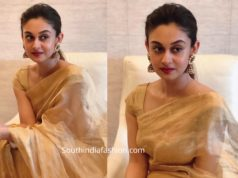 aishwarya arjun gold tissue saree
