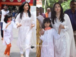 aishwarya and aaradhya in white suits at durga puja