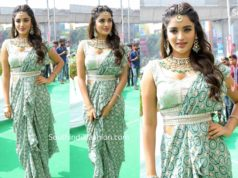 nidhhi agerwal saree with belt at manepally jewellery store launch