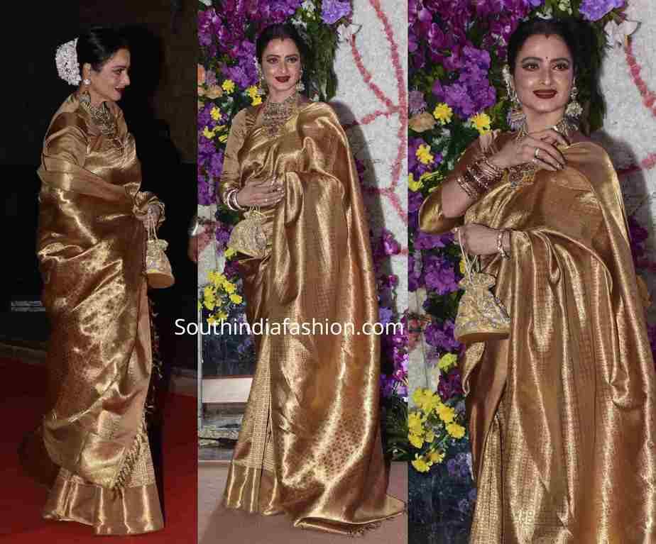 rekha gold kanjeevaram saree at a wedding reception (1)