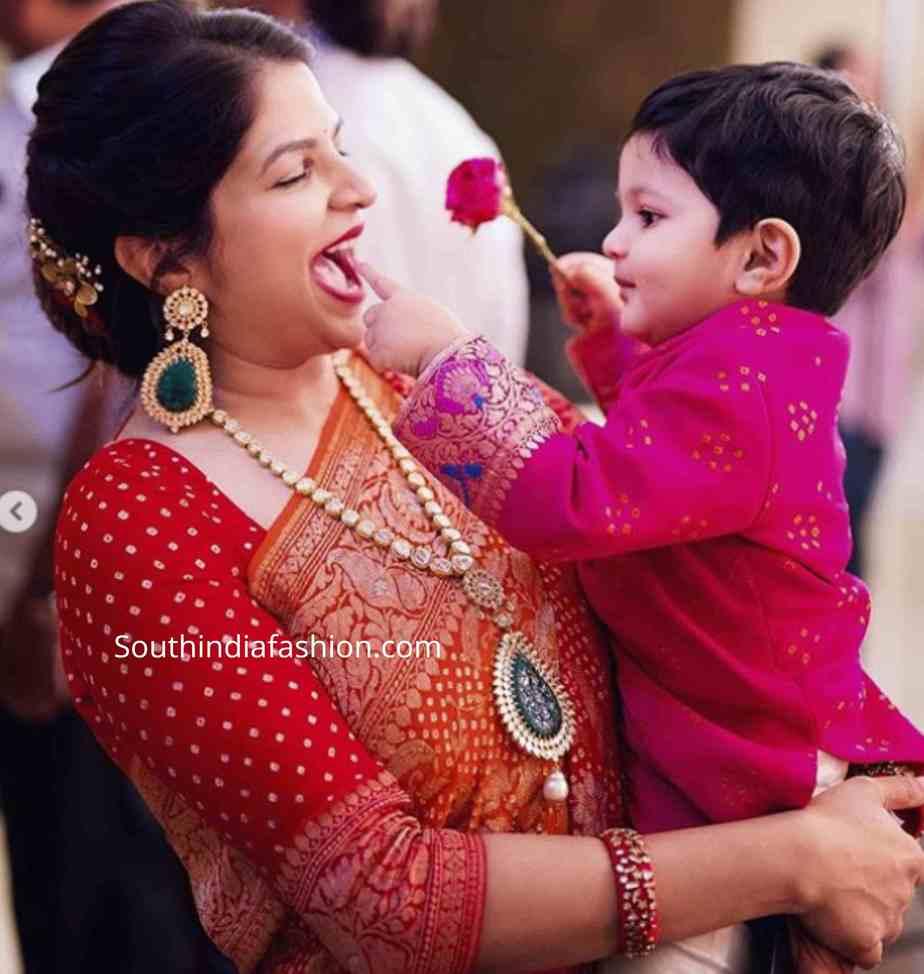 viranica manchu red saree at a wedding