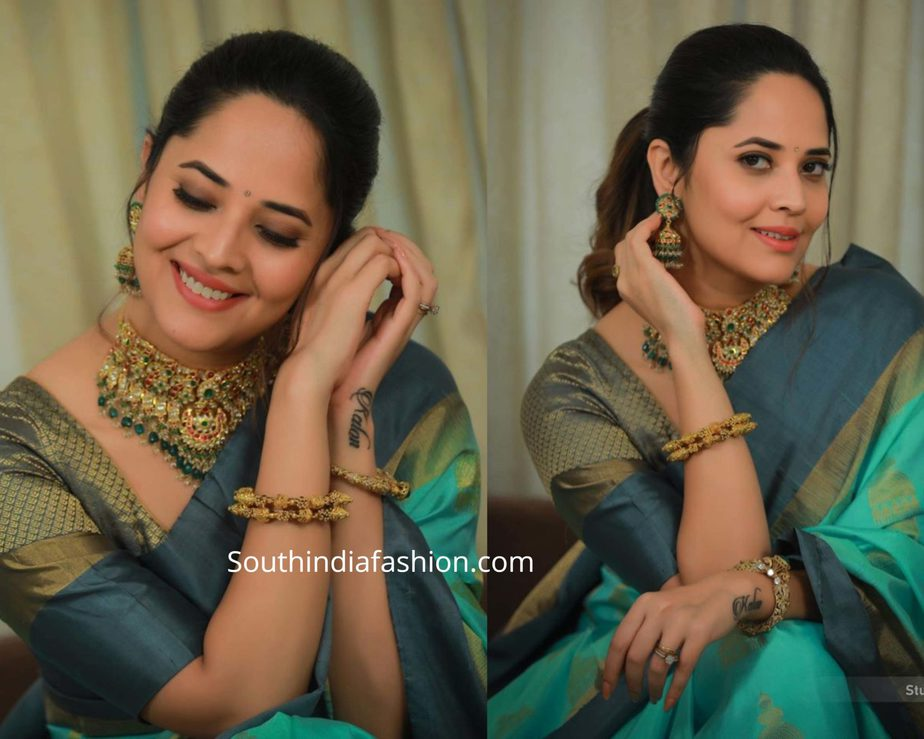 anasuya in green silk saree at a store launch