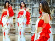 anchor anasuya in a white saree with red ruffle blouse