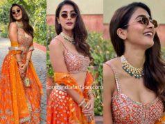 pooja hegde in orange lehenga at a wedding