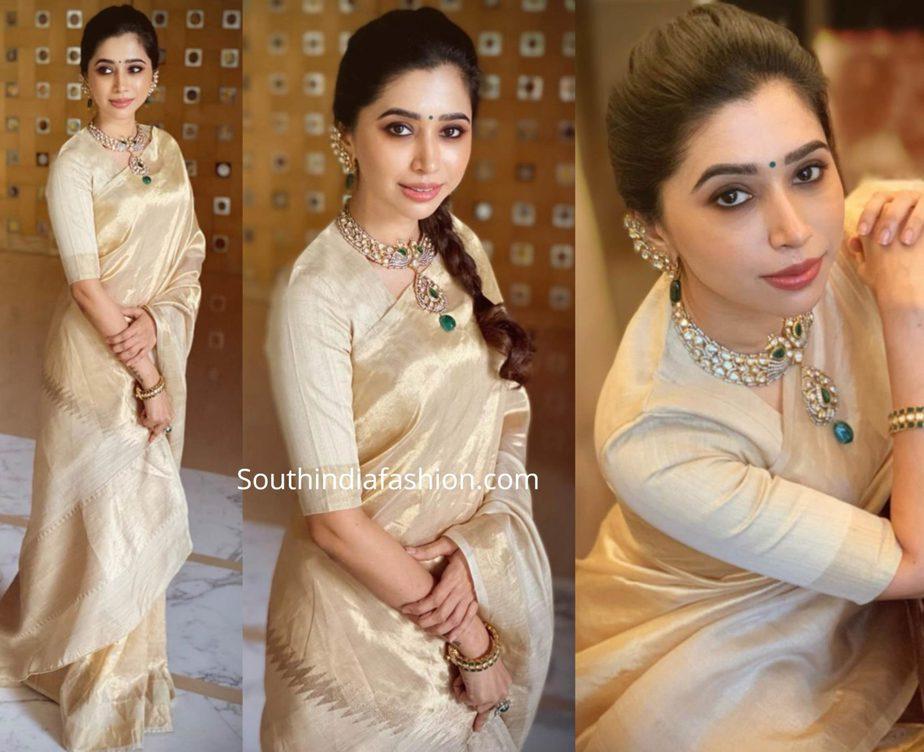 aarti ravi in gold tissue saree