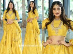 kritya karda in yellow lehenga
