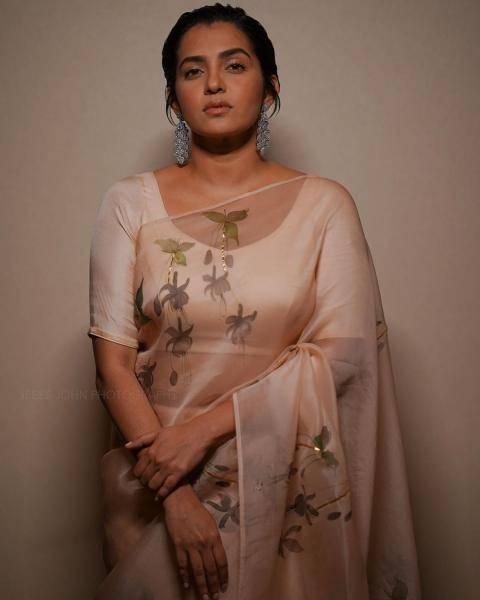 Parvathy thiruvothu in a U neckline blouse
