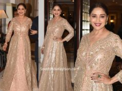 madhuri dixit in gold lehenga kurta at a wedding