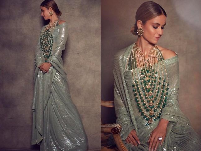 natasha poonawalla in sage green manish malhotra sequin saree