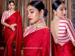regina cassandra in red saree and striped blouse at a wedding reception in chennai
