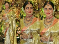 rekha in gold kanjeevaram saree at armaan jain wedding