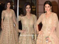 vedhika kumar in peach and gold anarkali at a wedding