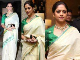 nadhiya in cream color kasavu saree at jayasudha son wedding reception