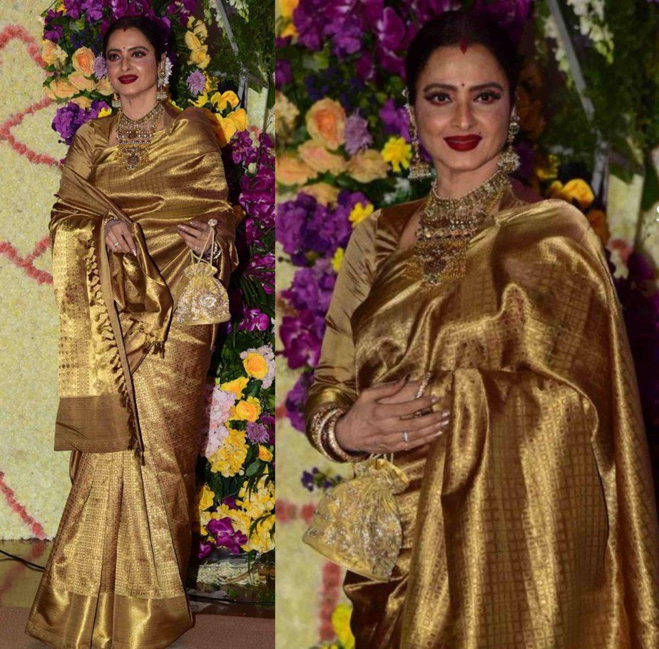 rekha in dark gold silk saree