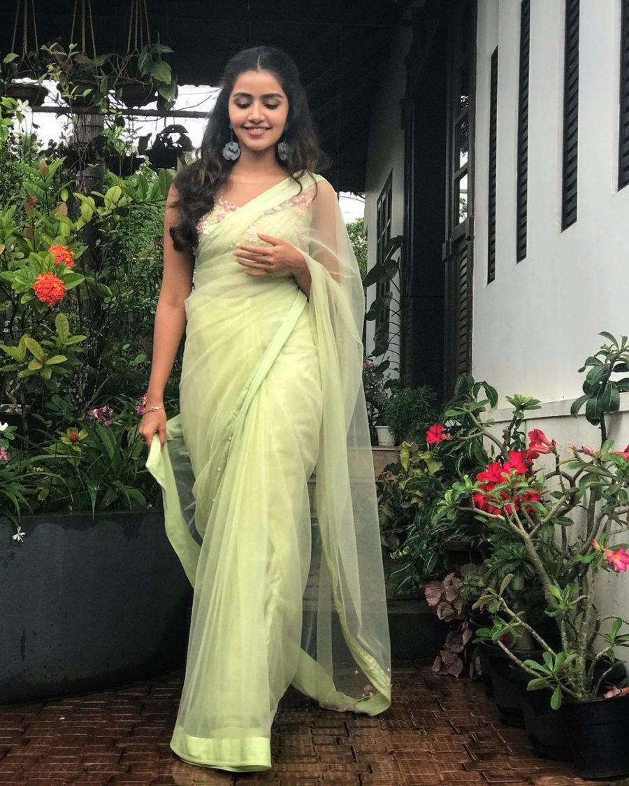 Anupama Parameswaran in green pastel saree