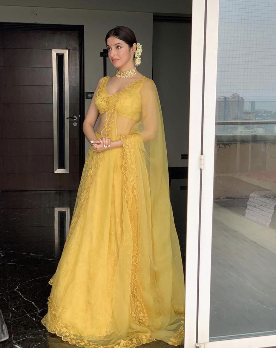 Divya in a yellow lehenga
